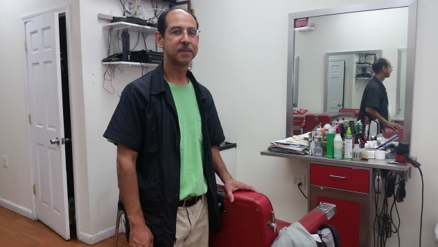 A photo of Jose, the owner of Alberto's Barbershop in Egleston Square, after our video and audio interview.
